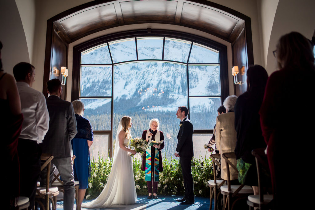 wedding with view of rocky mountains - Photo credit Sara Tom