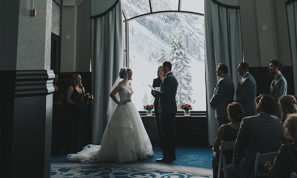 wedding in sunroom at chateau lake louise