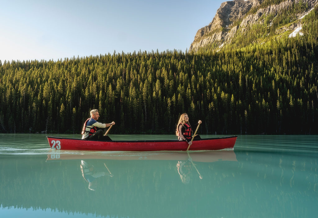 A couple canoes on the emerald waters of Lake Louise, Alberta.