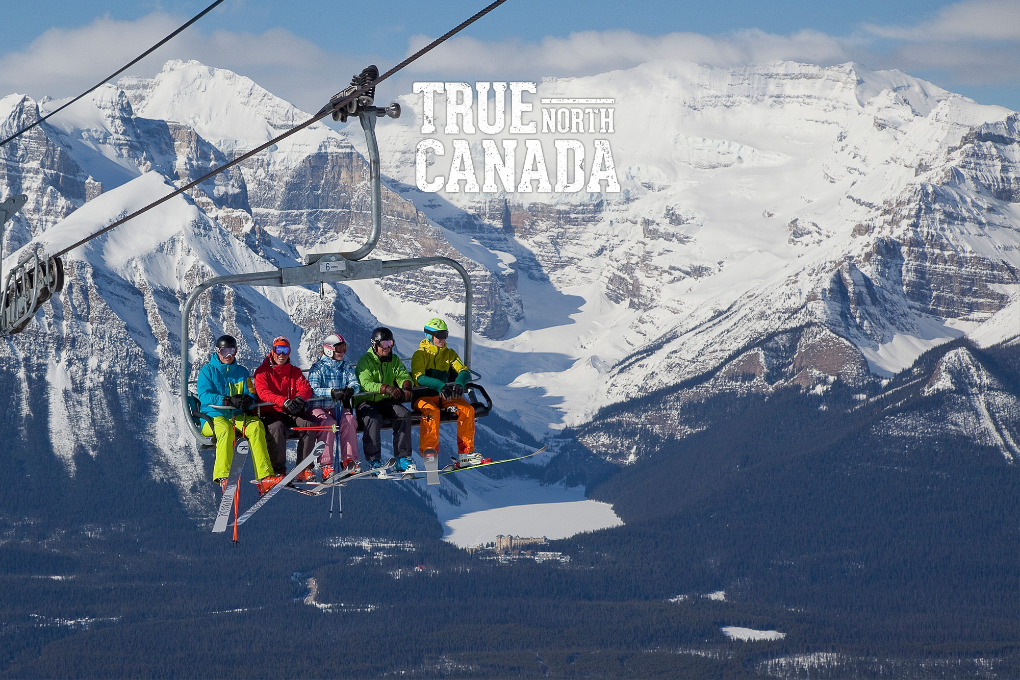 Chair lift at Lake Louise Gondola against snowy Rocky mountains