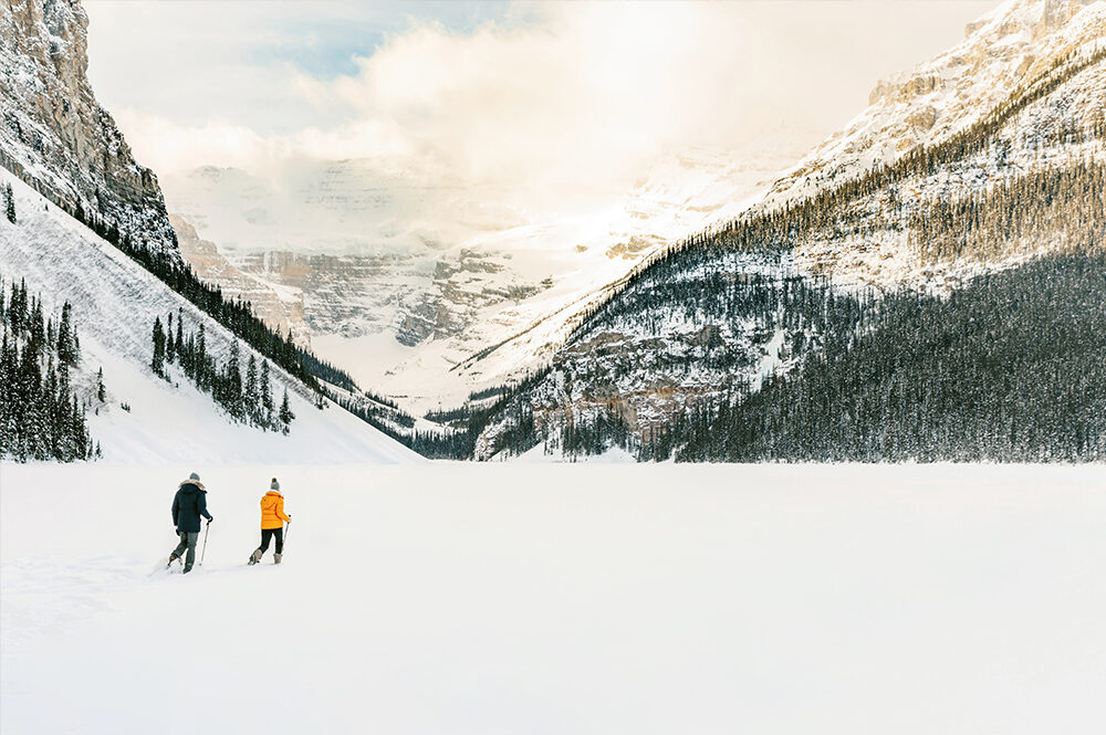 couple snowshoeing on lake louise